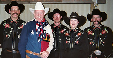 Ron Wilson, Cowboy Poet Lariat poses with Judy Coder and Pride of the Prairie.